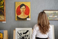 art gallery woman looking at a painting