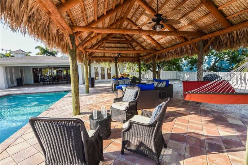 Outdoor covered seating area by pool in Anna Maria Island
