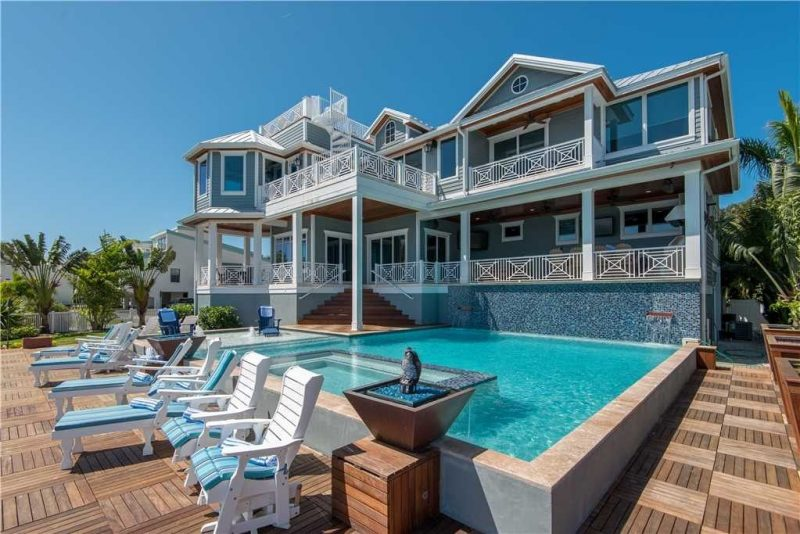 Exterior of multi level home with pool and large deck in Anna Maria Island