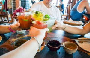 friends cheers for happy hour